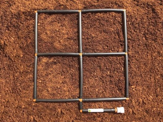 2x2 Garden Grid watering system plant spacing guide and ground level watering system
