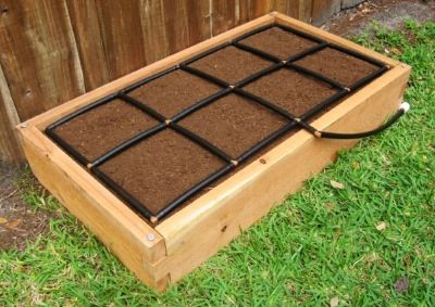 All-in-one, 2x4 Raised Garden Kit with Garden Grid watering system.