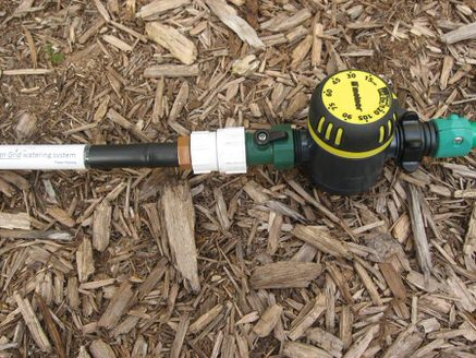 The Garden Grid with a one-way water flow valve and garden hose timer attached in-line.