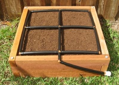 All-in-one, 2x2 Raised Garden Kit with Garden Grid watering system.