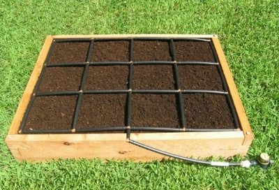 All-in-one, 3x4 Raised Garden Kit with Garden Grid watering system.